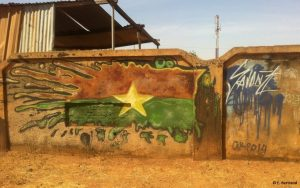 A mural in Ouagadougou depicts the flag of Burkina Faso.