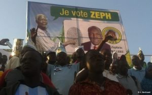 """UPC supporters stand in front of a campaign poster reading """"Je vote Zeph"""" in French, at a rally in Ouagadougou, Burkina Faso, November 2015."""